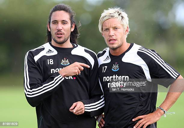 New signing Jonas Gutierrez talks to Alan Smith during a Newcastle United training session at the Little Benton training complex on July 16th 2008 in...