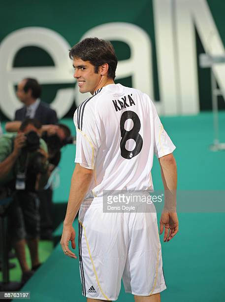 New signing Kaka poses during his official presentation as a Real Madrid player at the Santiago Bernabeu Stadium on June 30 2009 in Madrid Spain