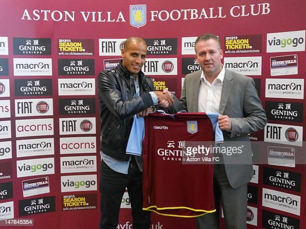 New signing Karim El Ahmadi and Aston Villa Manager Paul Lambert pose with an Aston Villa shirt at the Bodymoor Heath Trainng ground on July 22012 in...