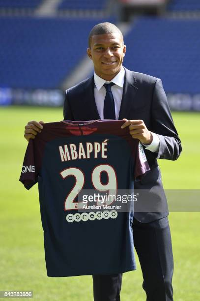 New signing Kylian Mbappe of Paris Saint-Germain poses for the media at the Parc des Princes on September 6, 2017 in Paris, France. Kylian Mbappe...