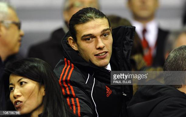 New signing, Liverpool's English forward Andy Carroll takes his seat before their English Premier League football match at Anfield in Liverpool,...