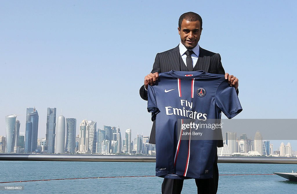 New signing Lucas Moura of PSG poses with a shirt as he is officially unveiled as a player of Paris Saint-Germain during a press conference and jersey presentation with Nasser Al-Khelaifi, president of PSG and Leonardo, manager of PSG, at the Museum of Islamic Art on January 1, 2013 in Doha, Qatar.