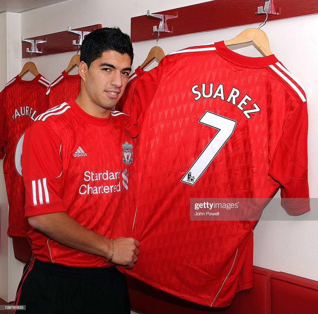 timeless design 017f2 3892e New signing Luis Suarez of Liverpool poses with his shirt at ...