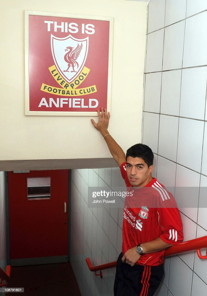 New signing Luis Suarez of Liverpool touches the This is Anfield sign at Anfield on February 3, 2011 in Liverpool, England.