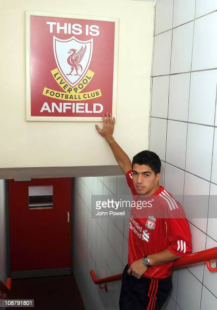 New signing Luis Suarez of Liverpool touches the This is Anfield sign at Anfield on February 3 2011 in Liverpool England