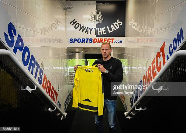 New signing Matz Sels poses for a photograph holding a named shirt in the tunnel at St.James' Park on June 28, 2016 in Newcastle upon Tyne, England.
