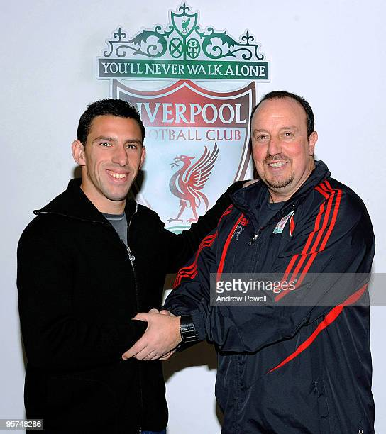 New signing Maxi Rodriguez of Liverpool shakes hands with manager Rafael Benitez at Melwood training ground on January 13 2010 in Liverpool England