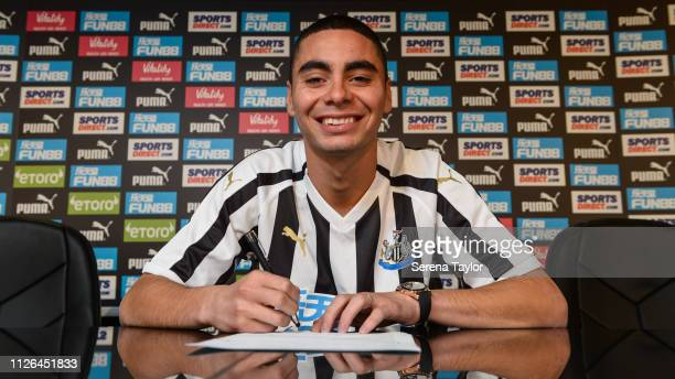 New signing Miguel Almiron poses for photos with the sponsorship boards at StJames' Park on January 30 2019 in Newcastle upon Tyne England