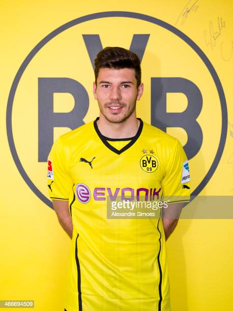 New signing Milos Jojic of Borussia Dortmund poses with his jersey on February 3 2014 in Dortmund Germany
