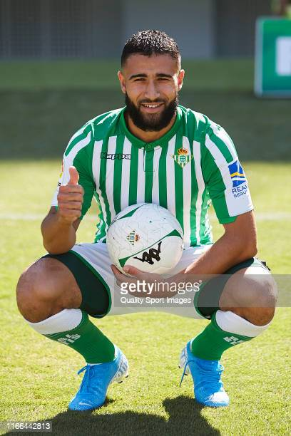 New signing Nabil Fekir poses for the media during his presentation as new player for Real Betis at Estadio Benito Villamarin on August 06, 2019 in...