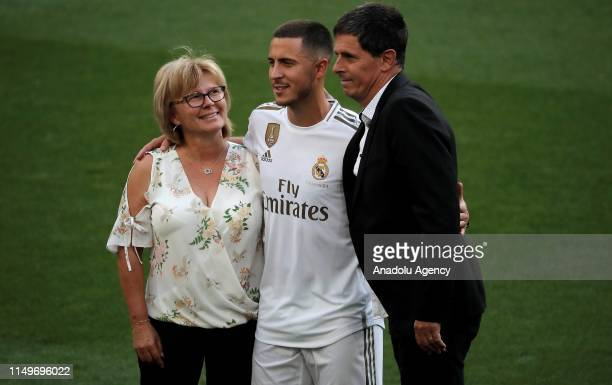 New signing of Real Madrid Eden Hazard poses for a photo with his mother Carine Hazard and his father Thierry Hazard during press release following...