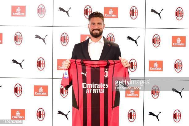New signing Olivier Giroud of AC Milan poses with the club's shirt at Casa Milan on July 16, 2021 in Milan, Italy.