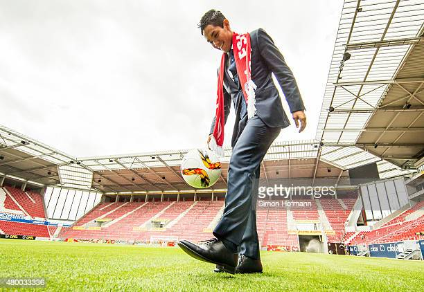 New signing player Yoshinori Muto of 1 FSV Mainz 05 juggles with the ball during his unveiling at Coface Arena during on July 9 2015 in Mainz Germany