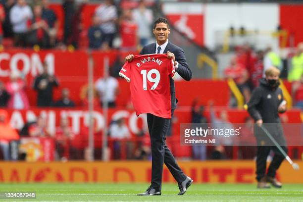 New signing, Raphael Varane of Manchester United is introduced to fans on the pitch prior to the Premier League match between Manchester United and...