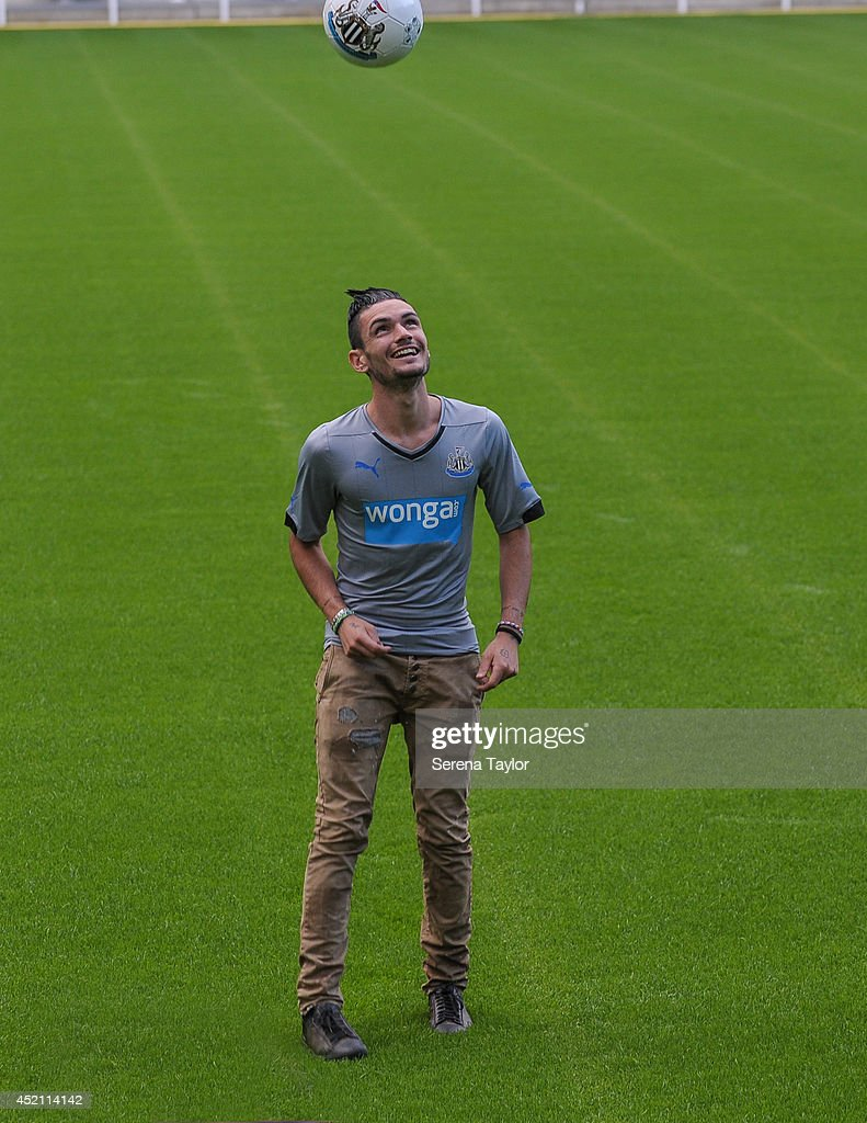 New signing Remy Cabella kicks a Newcastle United Football on the pitch at St.James' Park on July 13, 2014 in Newcastle upon Tyne, England.
