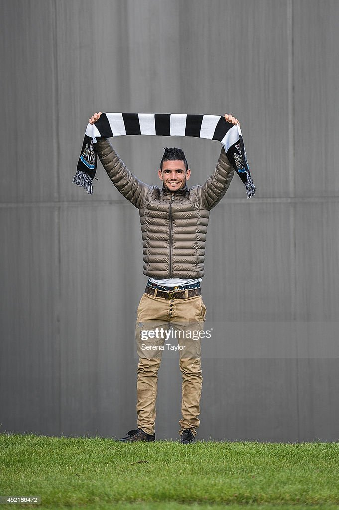 New signing Remy Cabella poses for photographs whilst holding a Newcastle United Scarf at The Newcastle United Training Centre on July 13, 2014 in Newcastle upon Tyne, England.