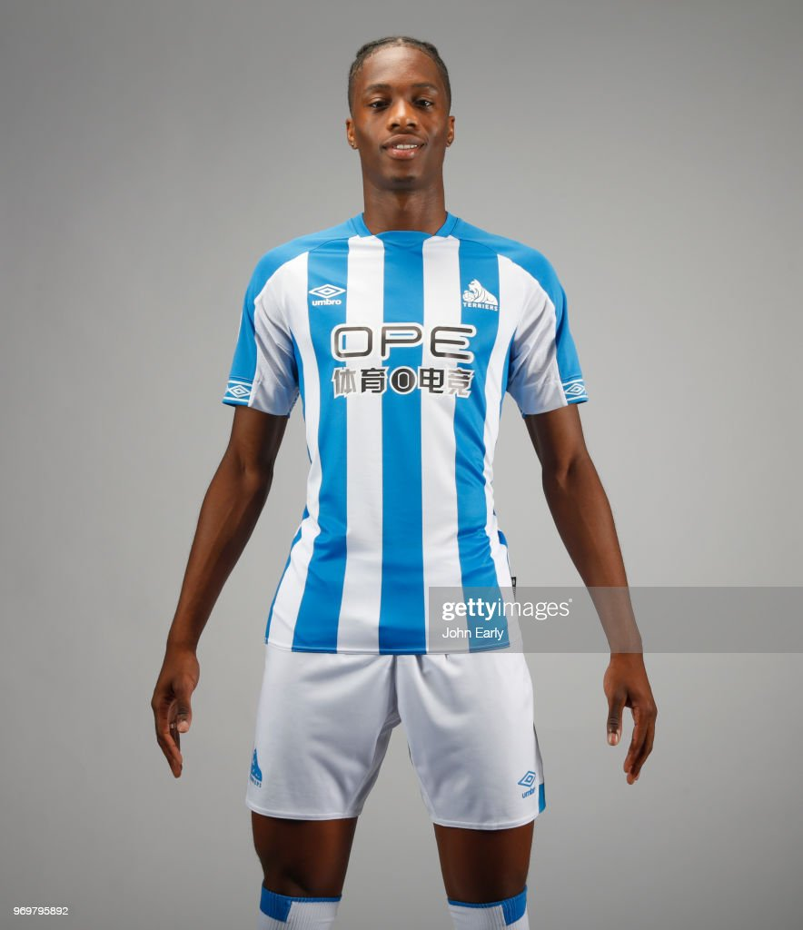New signing Terence Kongolo joins Huddersfield Town from AC Monaco and launches the new Umbro home kit on June 8, 2018 in Huddersfield, England.