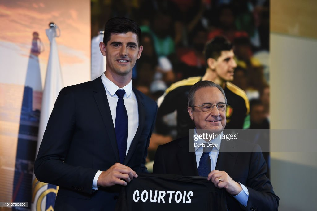 New signing Thibaut Courtois of Real Madrid is presented by Real Madrid president Florentino Perez to members of the press after he signed a six-year-deal with Real Madrid at Estadio Santiago Bernabeu on August 9, 2018 in Madrid, Spain.