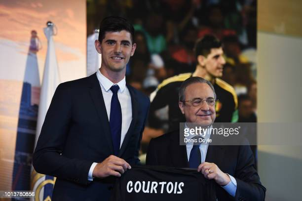 New signing Thibaut Courtois of Real Madrid is presented by Real Madrid president Florentino Perez to members of the press after he signed a...