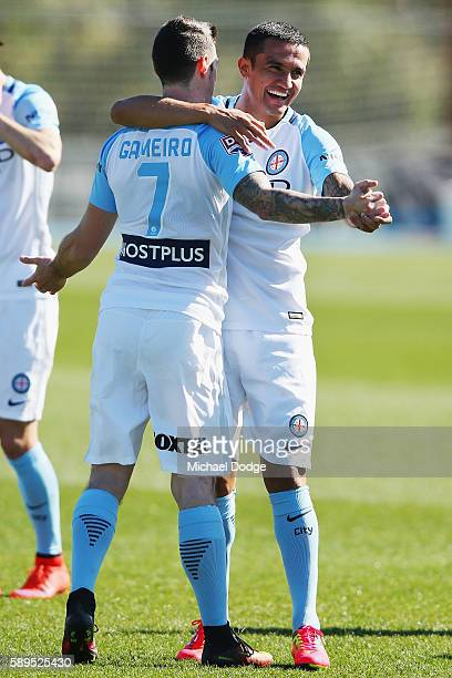 New signing Tim Cahill hugs Corey Gameiro of the City during a Melbourne City ALeague press conference at La Trobe University Sports Fields on August...