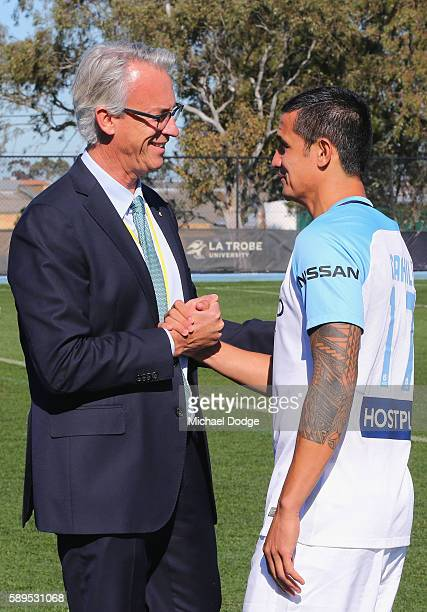New signing Tim Cahill is greeted by FFA CEO David Gallop during a Melbourne City ALeague press conference at La Trobe University Sports Fields on...