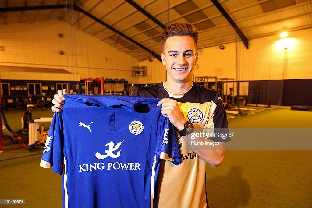 New signing Tom Lawrence of Leicester City FC poses with his shirt on September 1, 2014 in Leicester, England.
