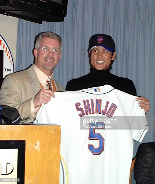 New signing Tsuyoshi Shinjo poses with New York Mets' General Manager Steve Phillips at Shea Stadium on December 18 2000 in New York City