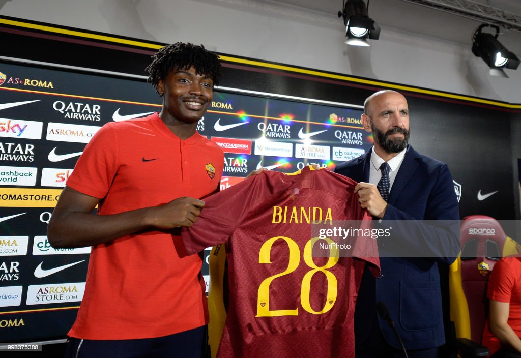 New signing William Bianda and Sport Director Ramon Rodriguez Verdejo Monchi pose for photographers with AS Roma Shirt during the press conference at the AS Roma Training Centre on July 07, 2018 in Rome, Italy.