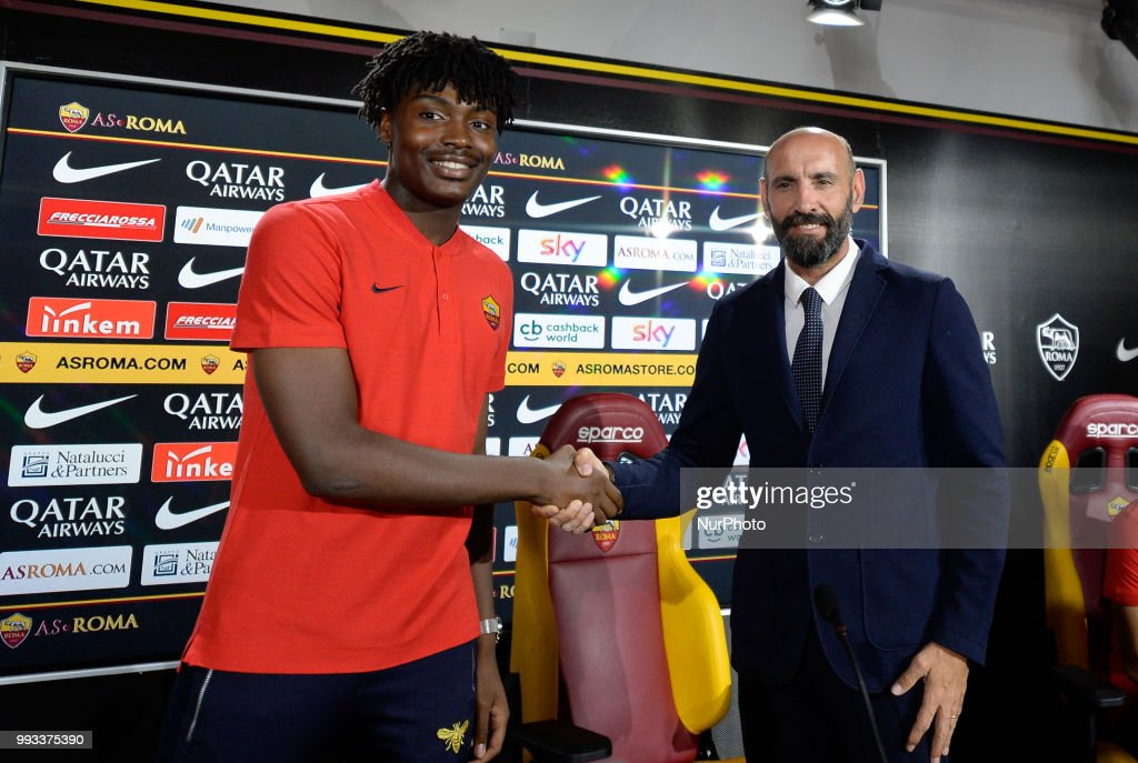 New signing William Bianda and Sport Director Ramon Rodriguez Verdejo Monchi pose for photographers during the press conference at the AS Roma Training Centre on July 07, 2018 in Rome, Italy.