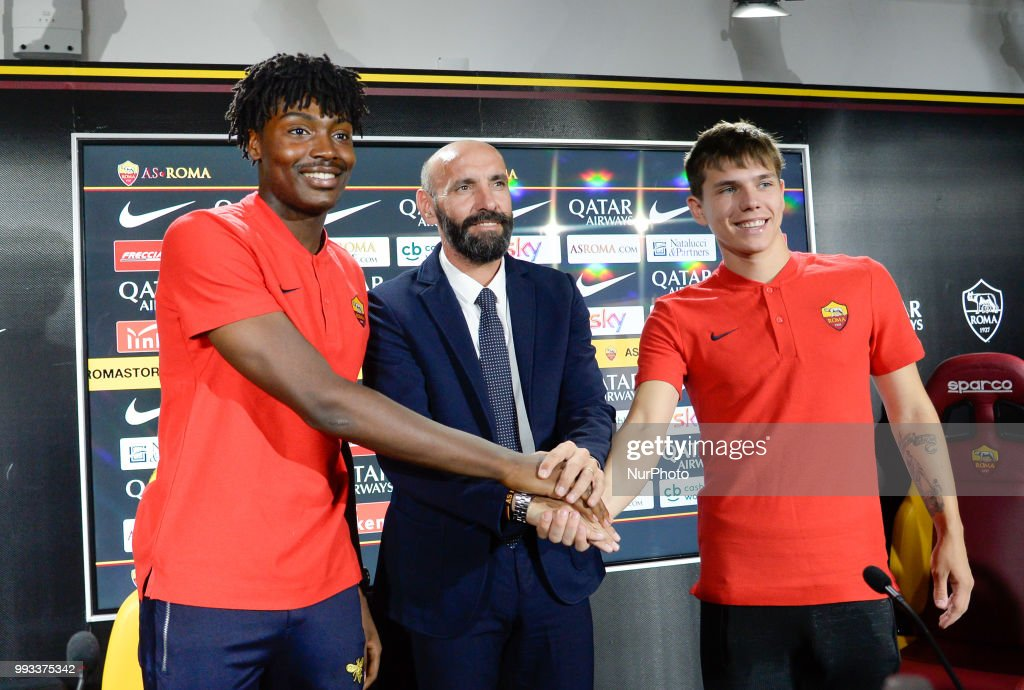 New signing William Bianda, Sport Director Ramon Rodriguez Verdejo Monchi and Ante Coric pose for photographers during the press conference at the AS Roma Training Centre on July 07, 2018 in Rome, Italy.