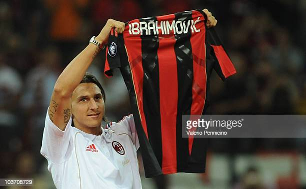 New signing Zlatan Ibrahimovic holds up his shirt during the Serie A match between AC Milan and Lecce at Stadio Giuseppe Meazza on August 29 2010 in...