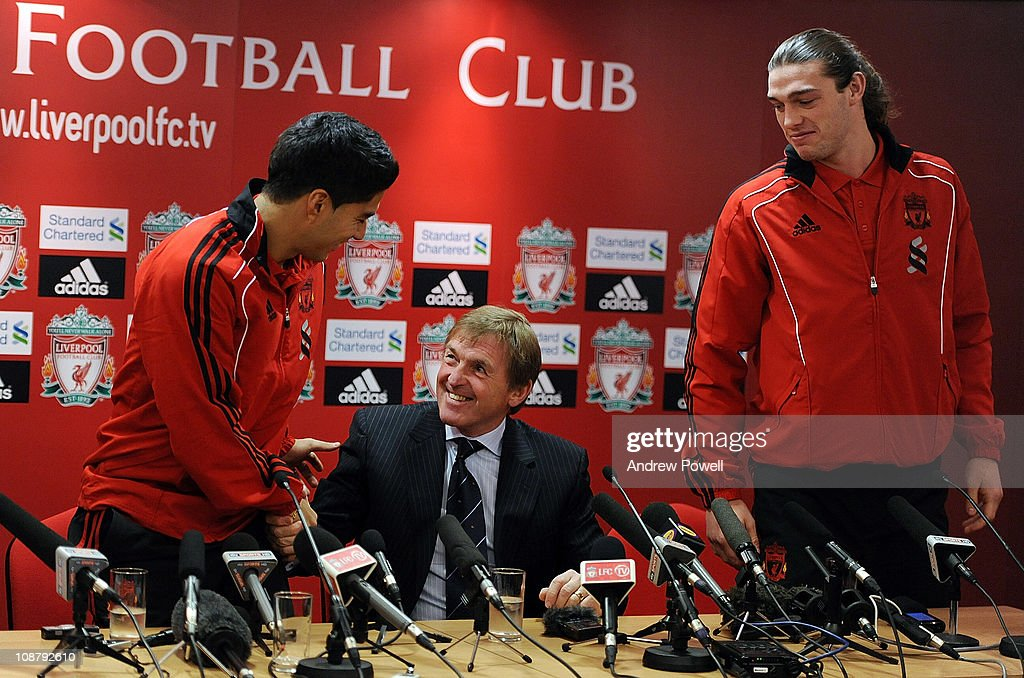 New signings Andy Carroll (R) and Luis Suarez (L) of Liverpool attend a press conference with manager Kenny Dalglish at Anfield on February 3, 2011 in Liverpool, England.