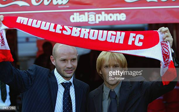 New signings Danny Mills and Gaizka Mendieta hold a Middlesbrough scarf above their heads before the FA Barclaycard Premiership match between...