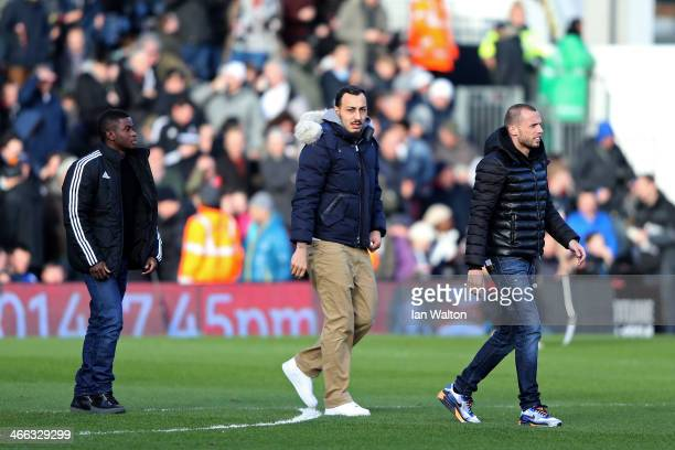 New signings Larnell Cole Kostas Mitroglou and John Heitinga of Fulham walk onto the pitch before the Barclays Premier League match between Fulham...