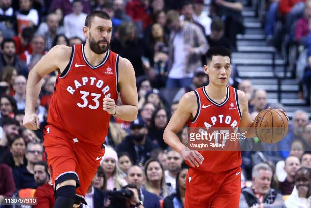 New signings Marc Gasol and Jeremy Lin of the Toronto Raptors bring the ball up court during the second half of an NBA game against the Washington...