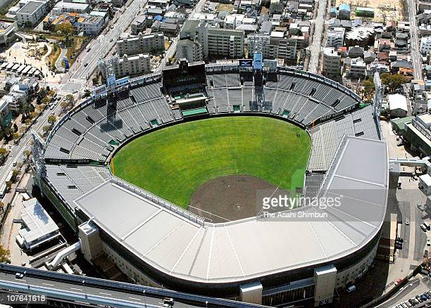 New silver roof construction work is completed at Hanshin Koshien Stadium on March 15, 2009 in Nishinomiya, Hyogo, Japan.