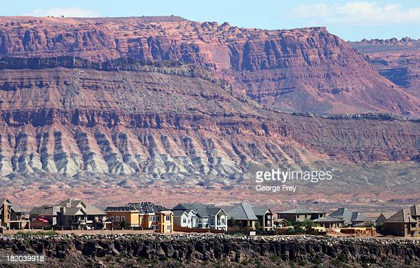 New singlefamily homes and others under construction are shown on a ridge September 27 2013 in St George Utah Housing starts on singlefamily rose at...