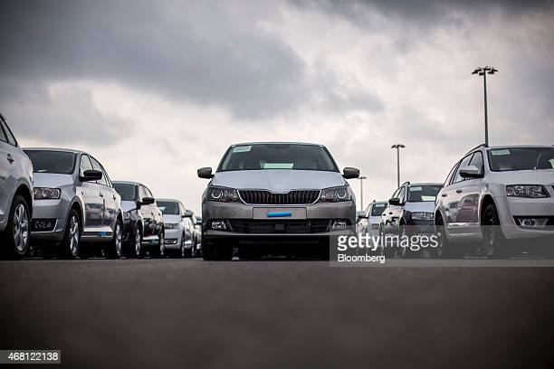 New Skoda automobiles stand in a parking lot ahead of distribution at Volkswagen AG's Skoda Auto AS manufacturing plant in Mlada Boleslav Czech...