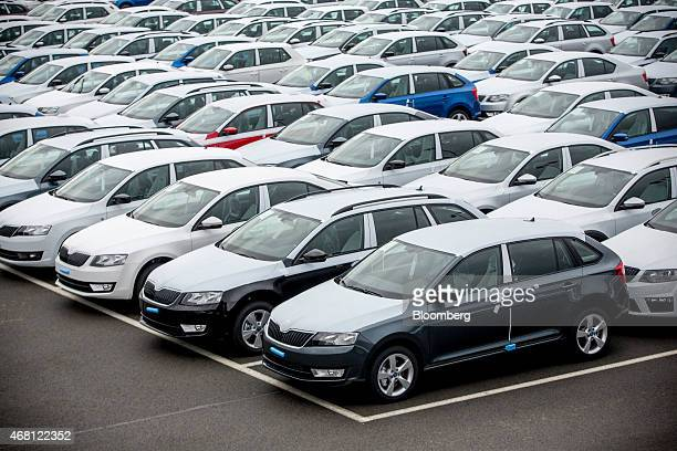 New Skoda Octavia automobiles stand in a parking lot ahead of distribution at Volkswagen AG's Skoda Auto AS manufacturing plant in Mlada Boleslav...