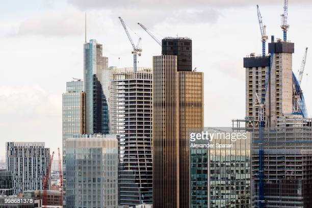 New skyscrapers under construction in London City financial district, England, UK