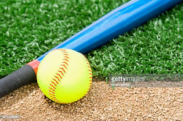 new softball and bat - softball stock pictures, royalty-free photos & images