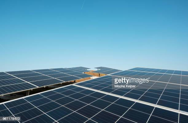 new solar farm constructed on former waste dump - solar panels stock photos and pictures