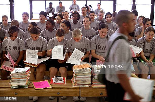 New soldiers await hearing and optical tests inside the 120th Adjutant General Battalion at Fort Jackson in Columbia South Carolina July 1 2009 With...