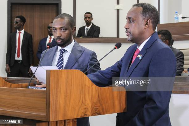 New Somali Prime Minister Mohamed Hussein Roble a Swedishtrained civil engineer is sworn in after Somali members of Parliament approved his...
