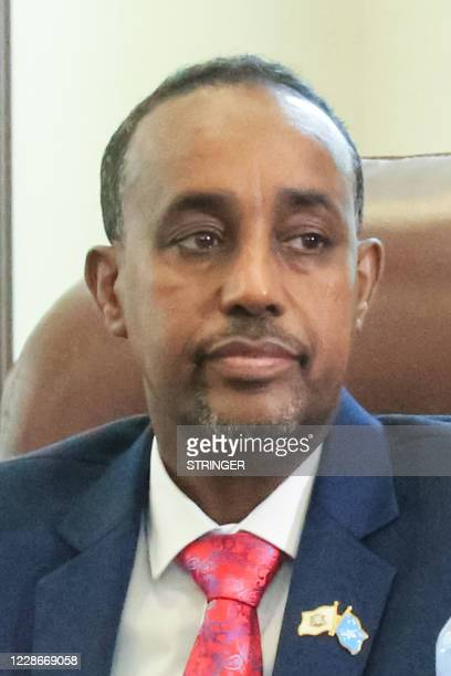 New Somali Prime Minister Mohamed Hussein Roble a Swedishtrained civil engineer sits after Somali members of Parliament approved his appointment in...