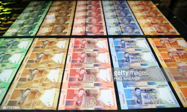New South African banknotes at the value of ten twenty fifty one hundred and two hundred South African Rand depicting former South African president...