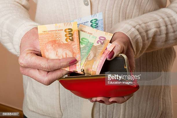 ZAR new South African banknotes in a woman's hand