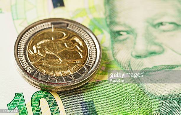 new south african ten rand banknote with r5 coin - south african currency stock photos and pictures