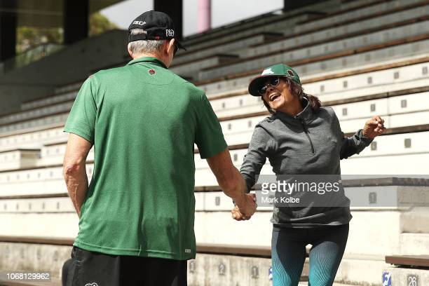 New South Sydney Rabbitohs Coach Wayne Bennett shakes hands awith a supporter as he walks out to the field during a Sydney Rabbitohs training session...