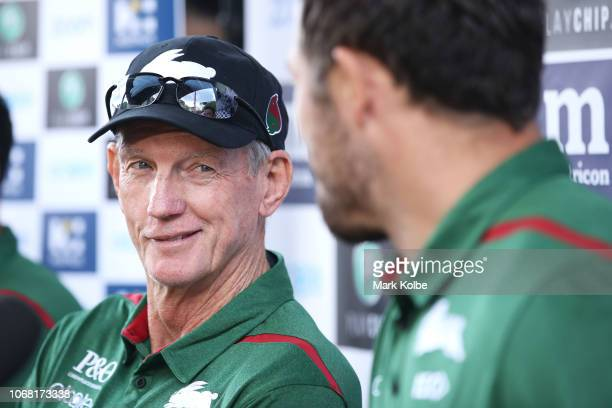 New South Sydney Rabbitohs Coach Wayne Bennett watches on Sam Burgess speaks to the media during a NRL press conference at Redfern Oval at Redfern...